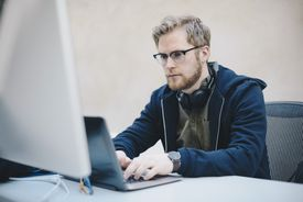 Male computer programmer using laptop