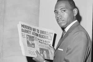 James Meredith, the first Black student to enroll at the University of Mississippi, holds a newspaper as he attempts to register at the university.