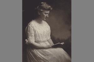 Photograph of Mary White Ovington, reading