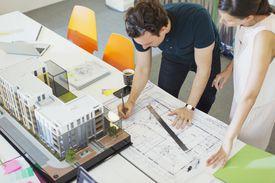 Architects drafting blueprint