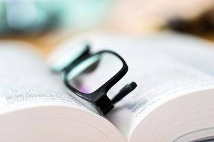 Close up glasses and open book