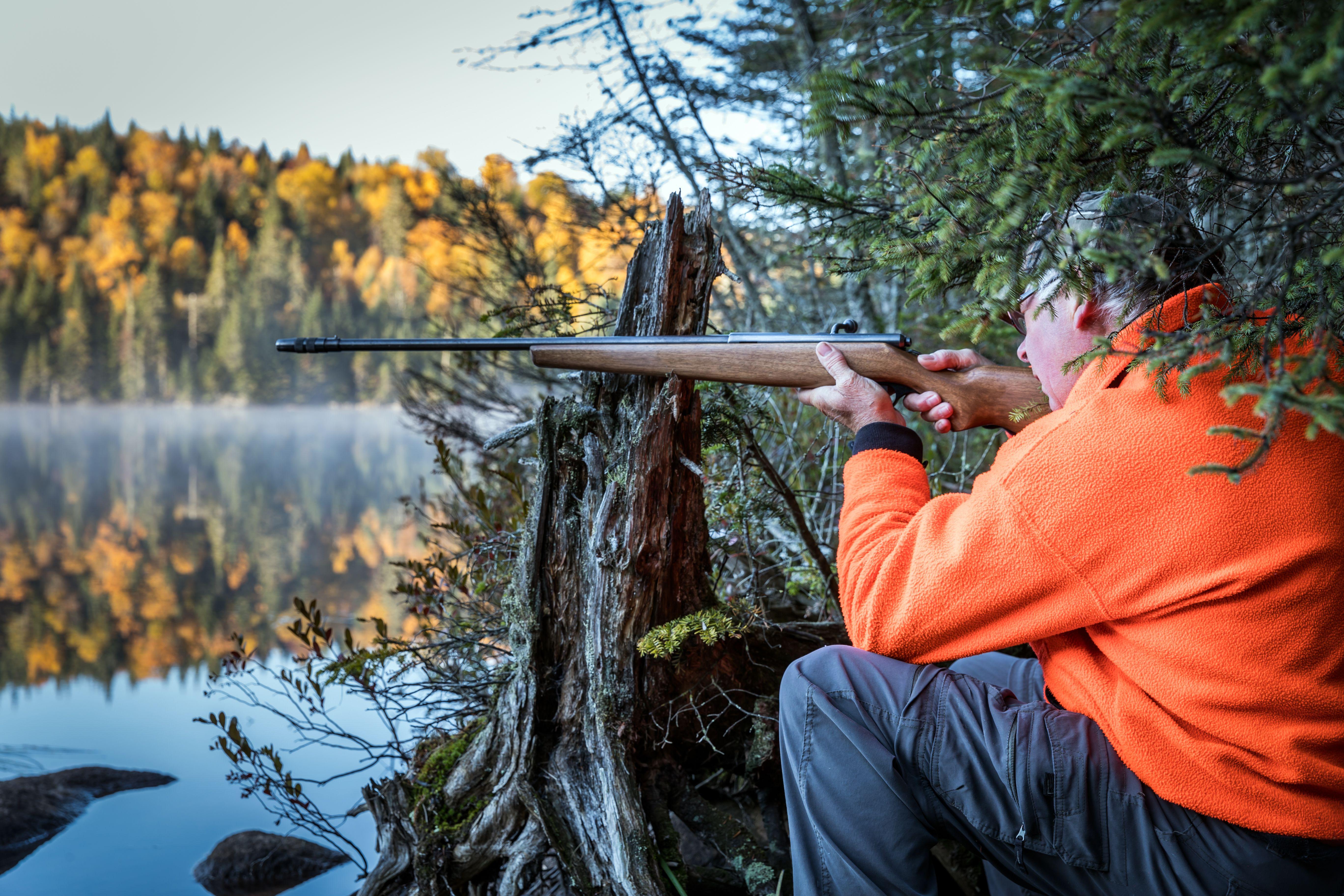 Senior Man Hunter Ready to Shoot a Target