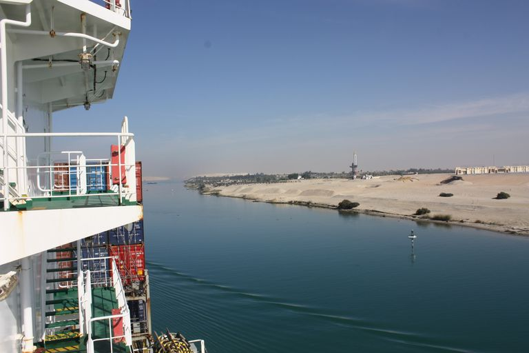 The side of a ship on the Suez Canal