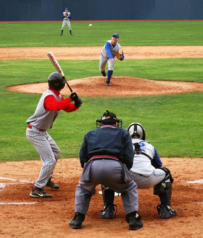 Pitcher Pitching Baseball To Batter