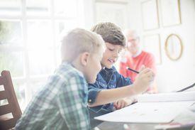 Children practicing prepositions