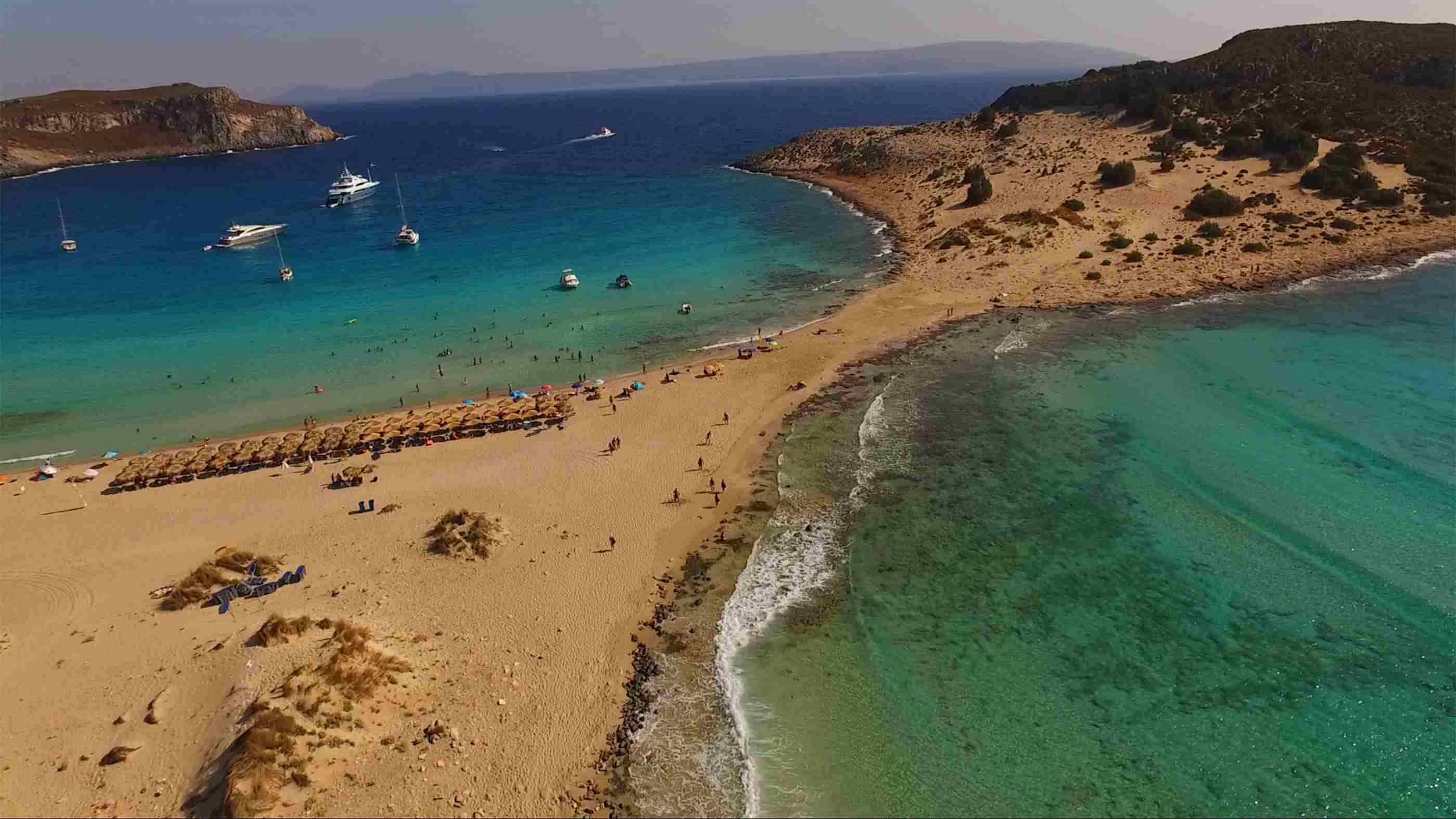 Aerial drone photo of iconic beach of Simos with turquoise waters, Elafonisos island, South Peloponnese, Greece