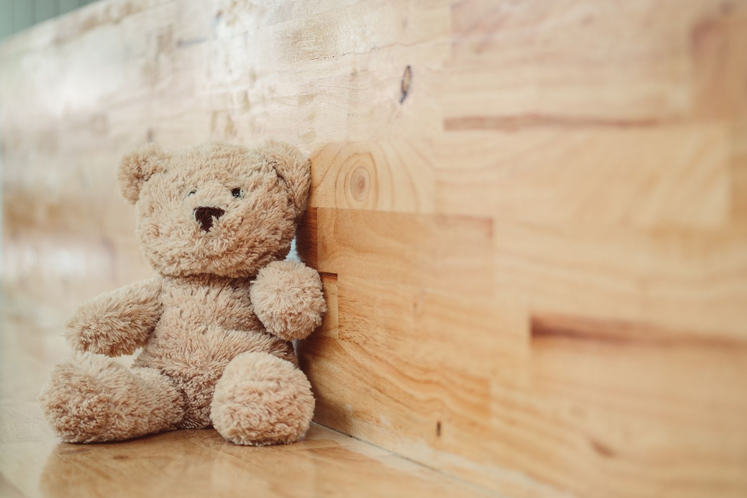 Close-Up Of Stuffed Toy On Wooden Table