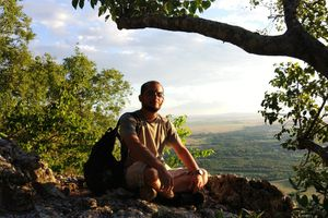 man sitting at scenic viewpoint in Paraguay