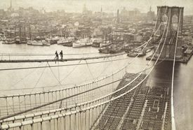 Photograph showing construction of the Brooklyn Bridge roadway.