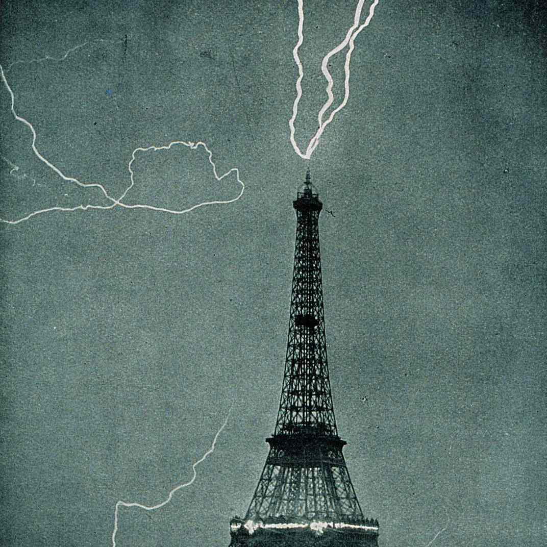 Lightning striking the Eiffel Tower, Paris, France.