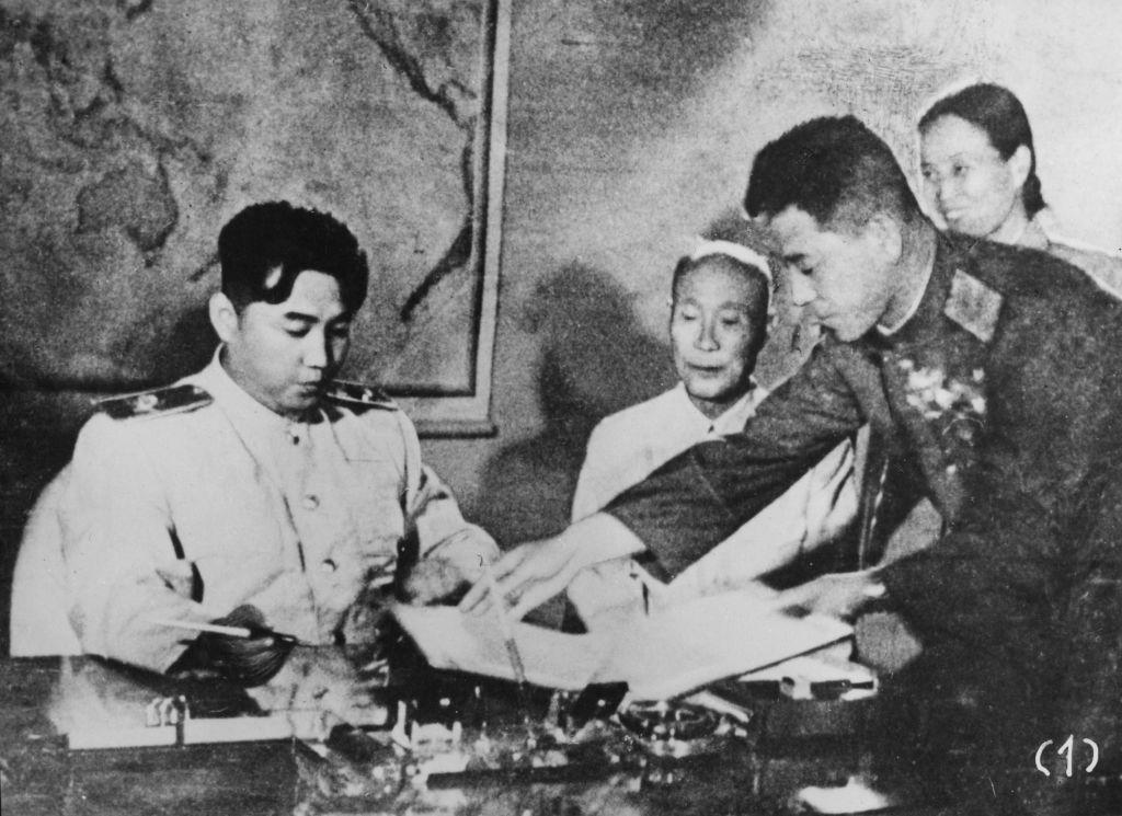 North Korean leader Kim Il-Sung signs the Korean Armistice Agreement at Pyongyang, North Korea, 1953