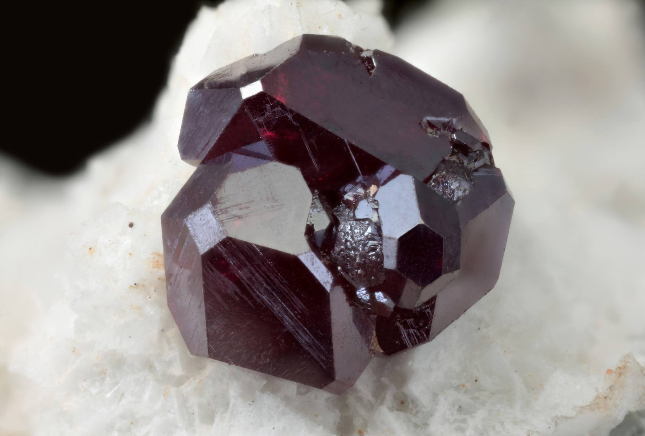 Cuprite mineral on a white and black background.