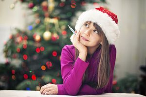 A girl working on a Christmas worksheet