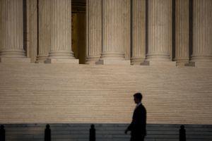 A man walks past the Supreme Court