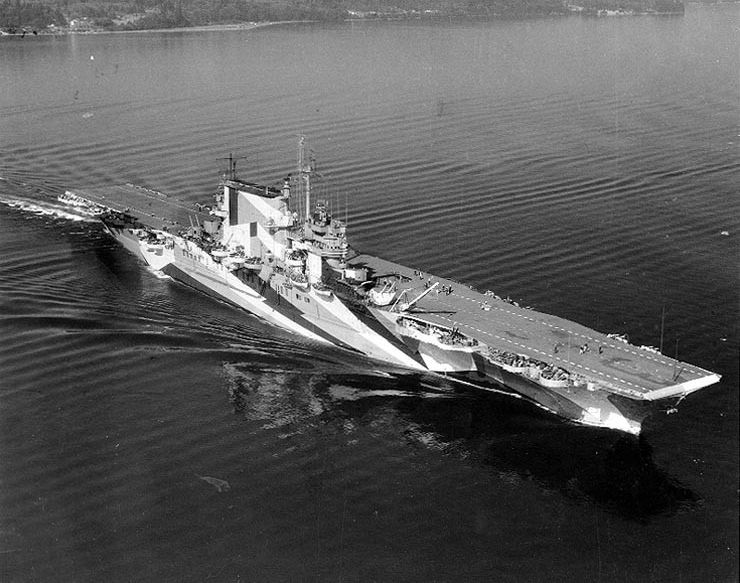 Aerial view of aircraft carrier USS Saratoga with camouflage paint.
