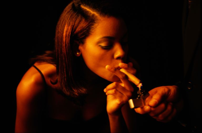 Woman Smoking a Cigar