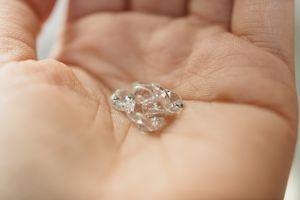 Close-Up Of Hand Holding Diamonds