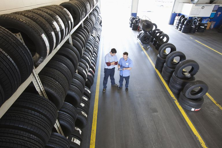 Two mechanics in tire center talking