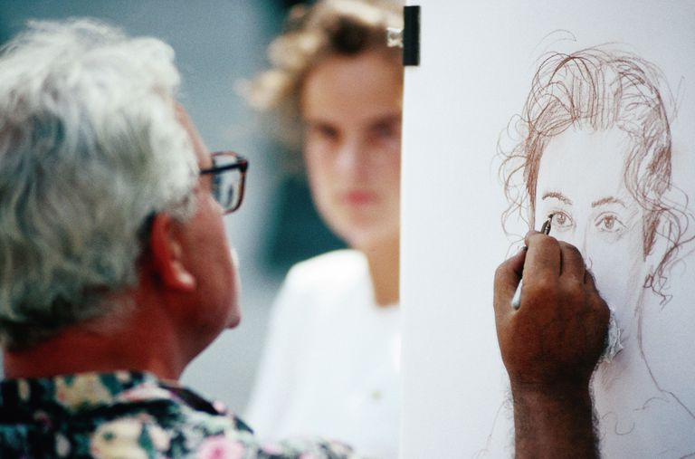 An artist drawing a portrait.