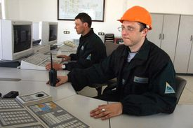 Chemical engineers supervise the central pumping station at the Yukos Oil and Gas company