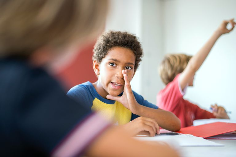 Boys whispering in class
