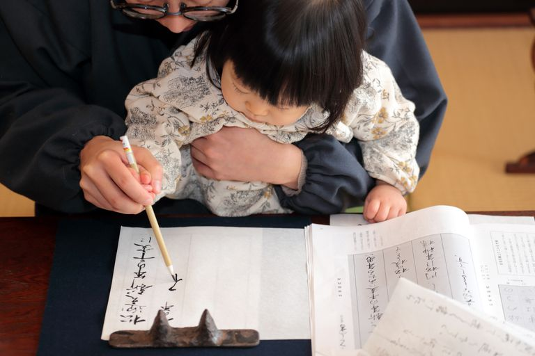 Young child learning Japanese