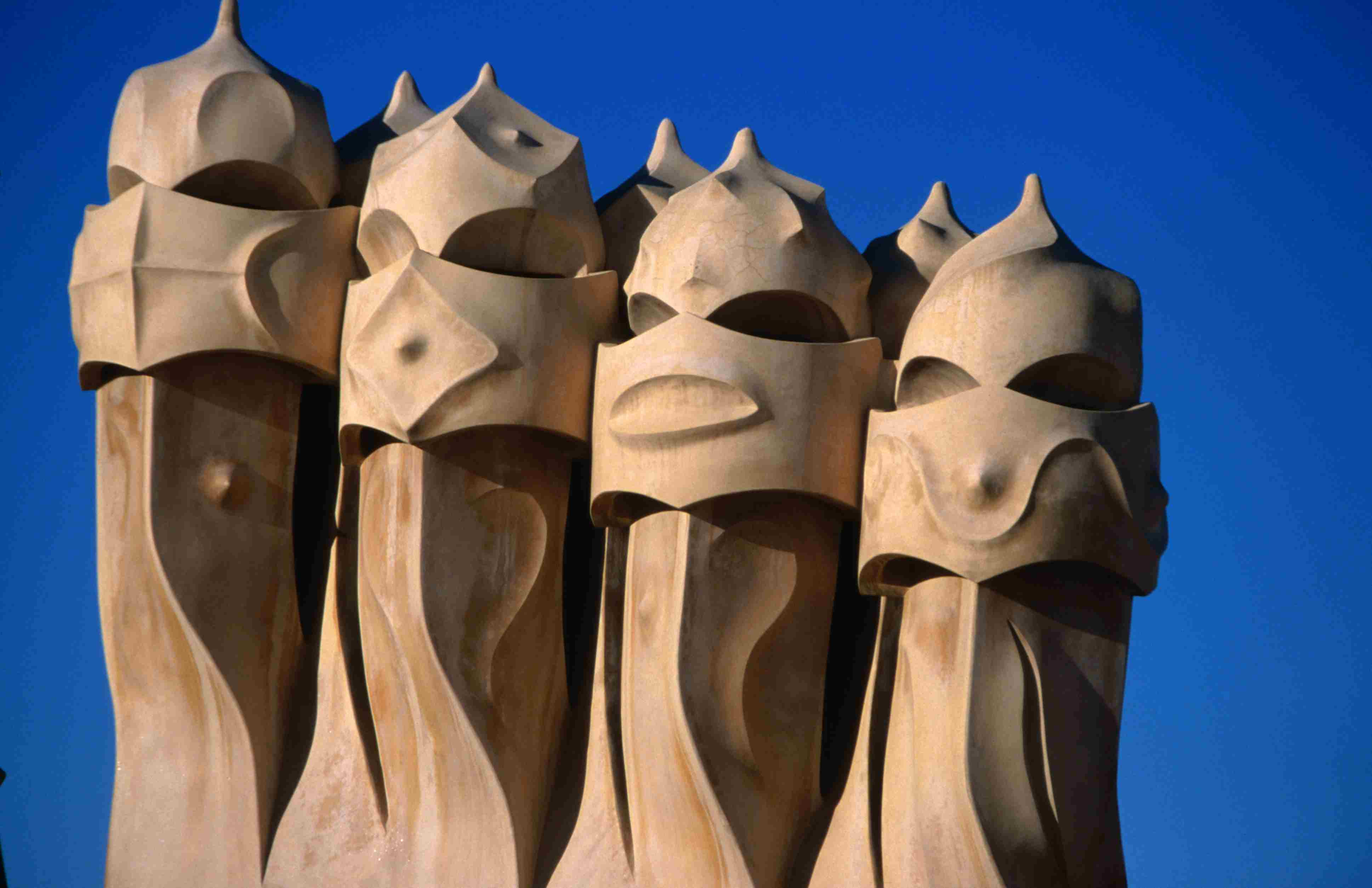 four chimney pots looking like four masked persons in clay