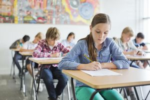 Students filling out worksheets in class