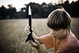 A Boy with a Model Rocket