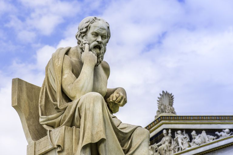 statue of Socrates sitting and thinking