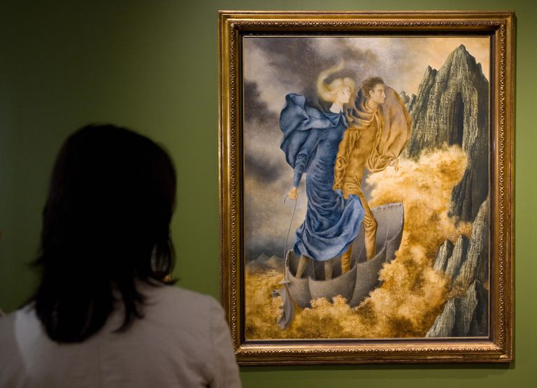 A woman looks at a painting of two figures inside an upturned umbrella as they ride a gold cloud into a mountain