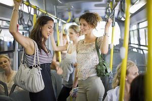 Women interacting on a bus