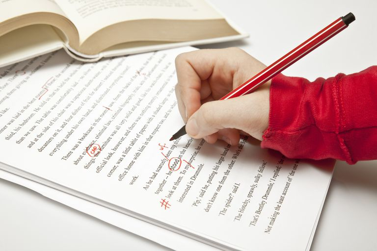 Grammatical errors being marked in red pen on a document