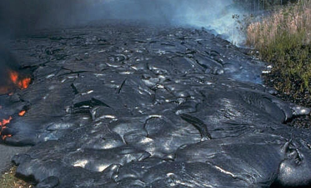 Pahoehoe lava flow solidifying into rock.