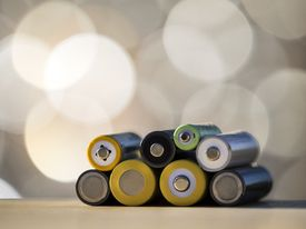 Heap of rechargeable batteries of differentes sizes. NiMH rechargeable.