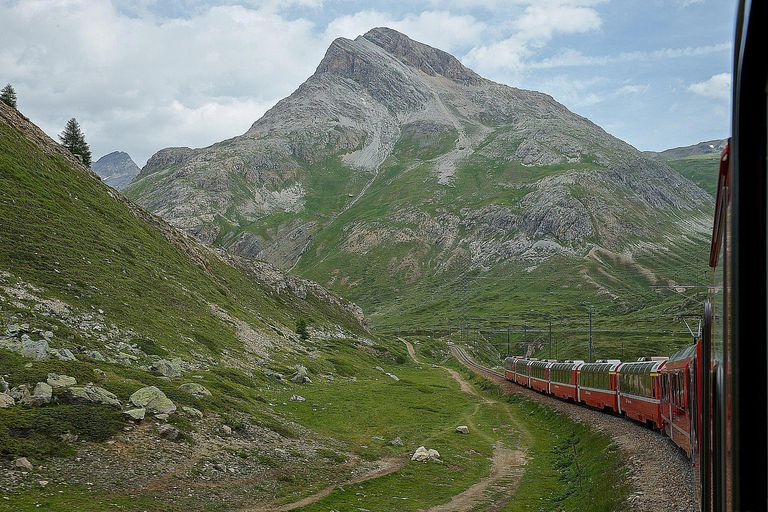 climactic order: Train winds through mountain landscape