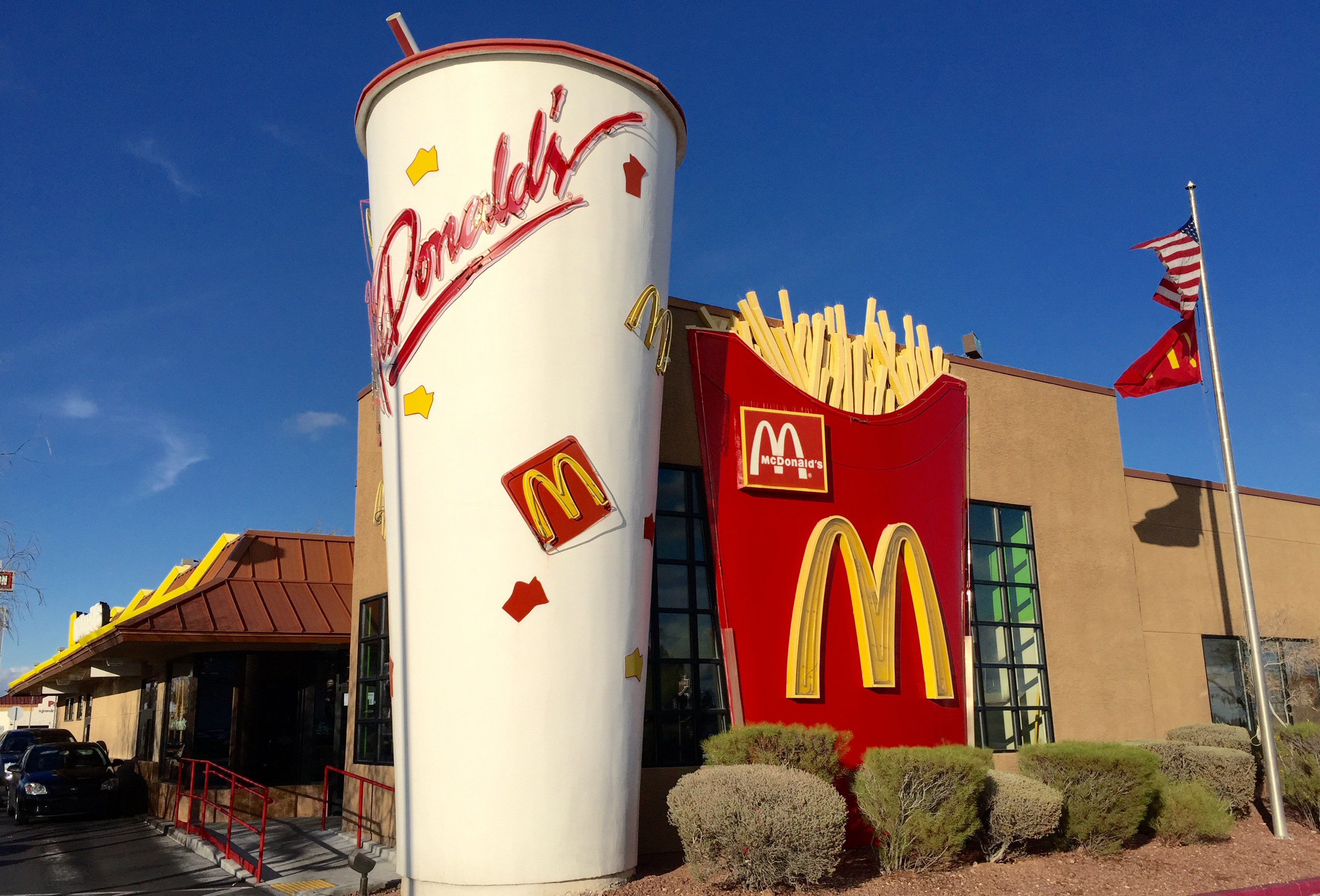 McDonald's restaurant with a huge soda and fries built into the facade