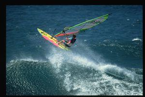 Windsurfer at Ho'okipa Beach Park, Maui jumping on wave