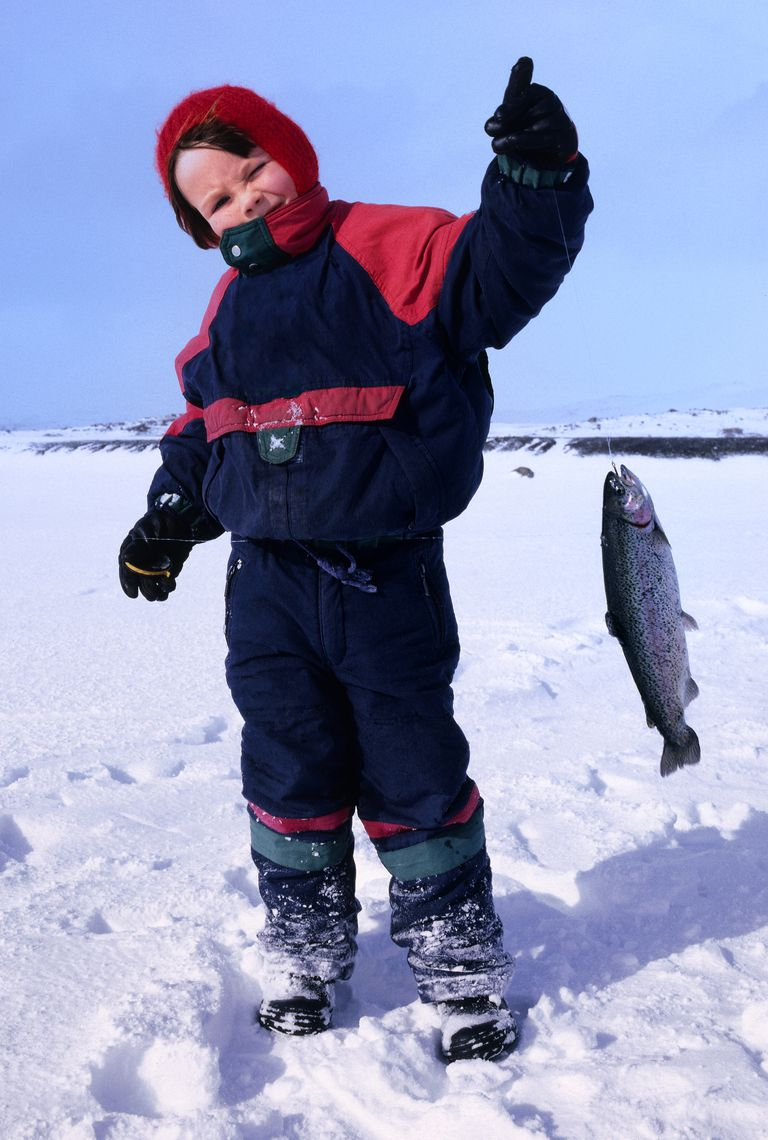 Young boy holding a fish, Ice Fishing Iceland