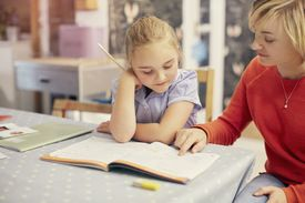 Woman teaching young girl