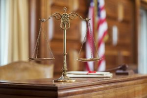 Scales of justice on the judge's bench