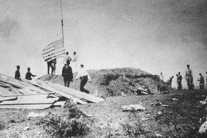 US Marines raising the American Flag over Guantanamo Bay