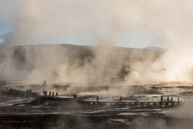 Geysers and tourists on the boardwalk in Norris Basin in Yellowstone Park