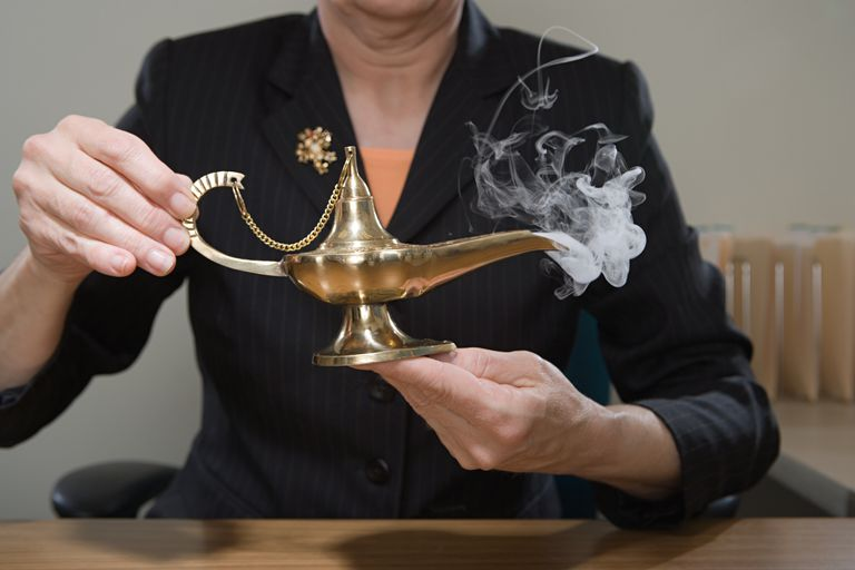 a person holding a genie lamp emitting vapors