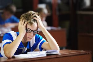student struggling to read at desk