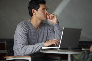 side profile of man working on laptop, thi...