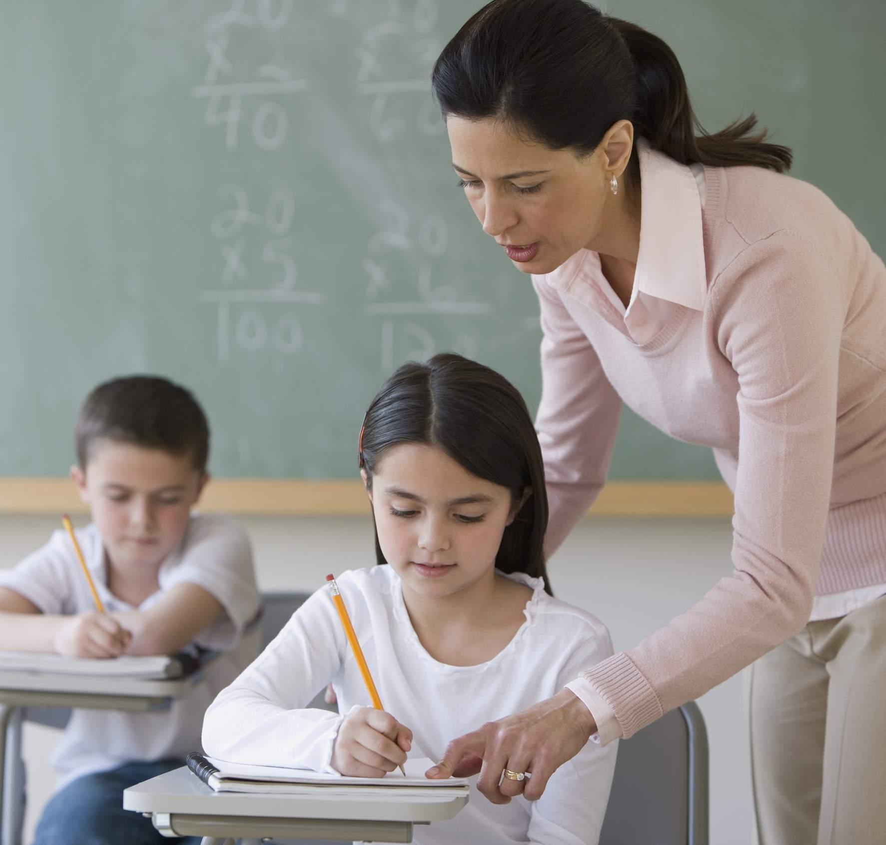 Female teacher helping student