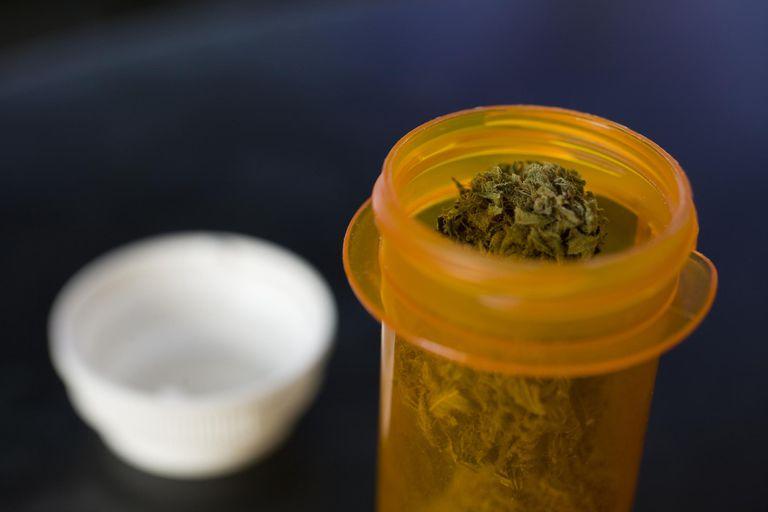 Marijuana in open medicine bottle