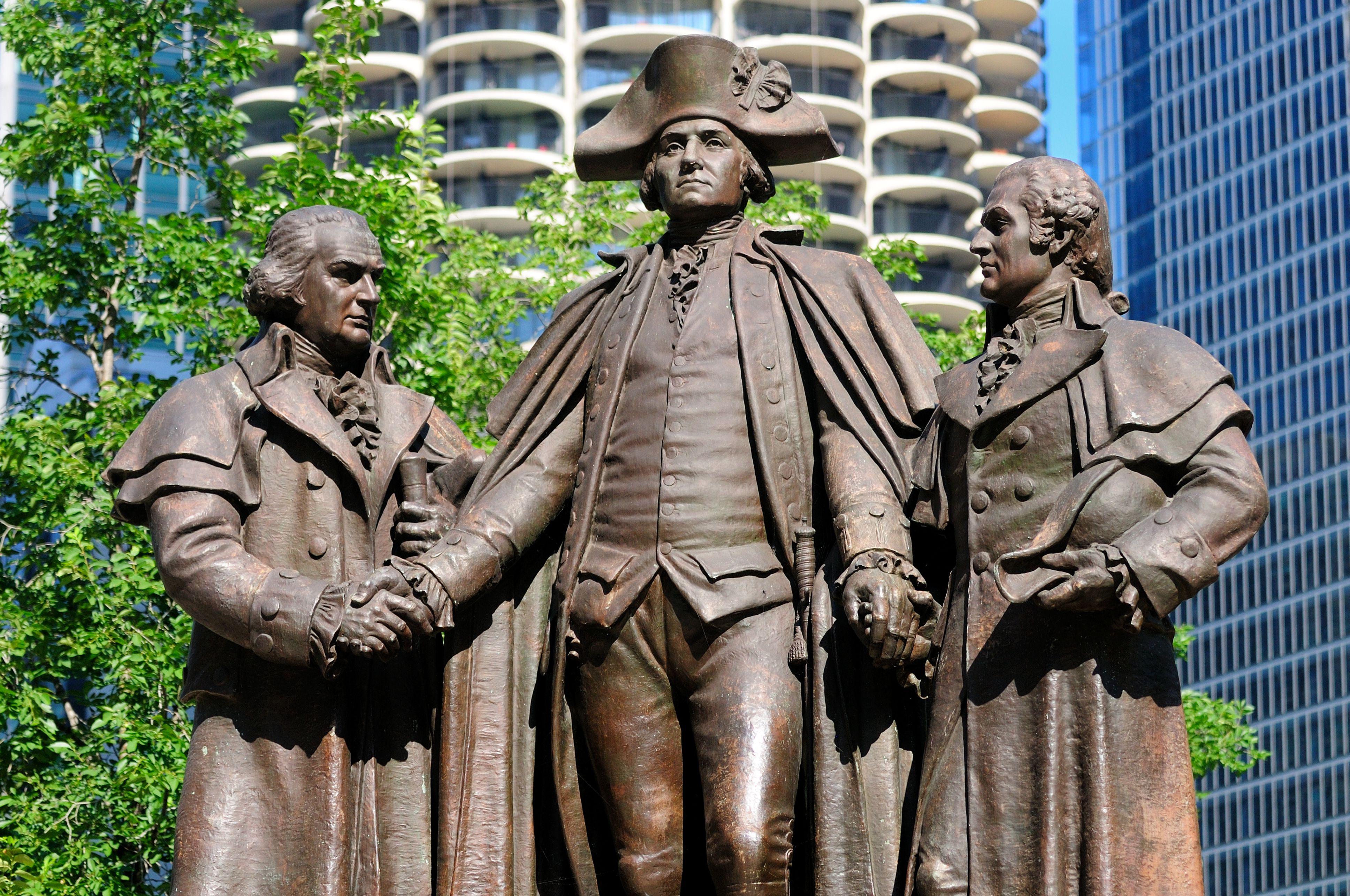Statue of Robert Morris, George Washington and Haym Salomon rests on Wacker Drive, Chicago, Illinois, USA