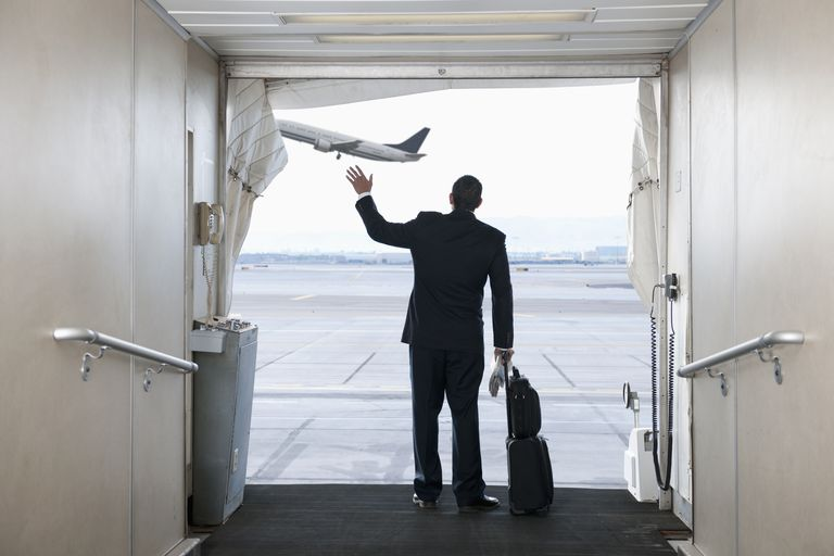 Man waves from end of jet bridge